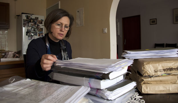 Carmen Bugan in 2013 reading secret police files made about her family's life in communist Romania.